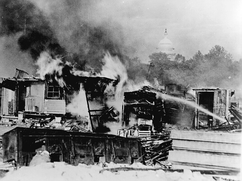 The Bonus Army encampment burns with the U.S. Capitol in the background (National Archives)