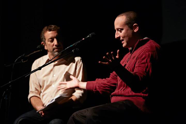 Diarist Josh Cutler speaking on stage in Chicago with Radio Diaries founder Joe Richman.